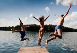family-on-summer-vacation-jumping-into-lake