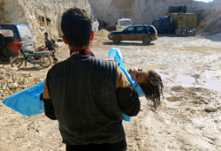 A man carries the body of a dead child, after what rescue workers described as a suspected gas attack in the town of Khan Sheikhoun in rebel-held Idlib, Syria April 4, 2017. (Photo: Ammar Abdullah/Reuters)