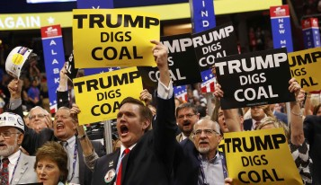 Delegates from West Virginia hold signs supporting coal on the second day of the Republican National Convention in Cleveland, Ohio, U.S. July 19, 2016.  REUTERS/Aaron P. Bernstein